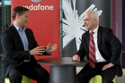 Vodafone  chief Russell Stanners (left) and Spark's Simon Moutter say customers are benefiting from competition.  Photo / Brett Phibbs