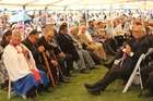 Elders of the hau kainga (home people) sit opposite the manuhiri (guests) during the welcome.