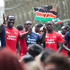 The Kenyan team waves to the crowd from their float. Photo / Mark Mitchell