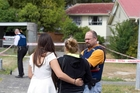 A neighbour among onlookers at the Hamilton address says she had heard there was a stabbing. Photo / Christine Cornege