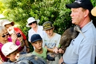 A group of Whangarei residents get up close and personal with Goldie the kiwi, held by Todd Hamilton, project manager of the Whangarei Heads Landcare Forum. Photo / Malcolm Pullman
