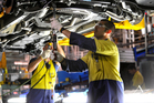 Automative manufacturing employees work on the assembly line at the Ford Broadmeadows plant in Melbourne. Photo / AAP