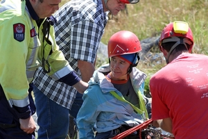 Rescuers help pull Jill Clendon from the sinkhole on Takaka Hill, near the Ngarua Caves. Photo / Tim Cuff