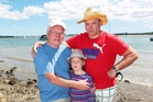 Alistair Kennedy (left), granddaughter Molly and her father, Simon Butler, after yesterday's close call at Bucklands Beach. Photo / Doug Sherring