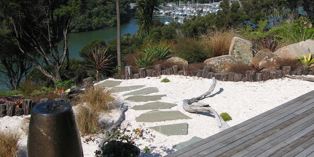 Inset flagstones into a terrace of shell or lime chip and plant ground covers or succulents into the shell.