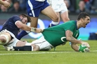 Rob Kearney dives over the line during Ireland's walkover against Scotland to claim the Six Nations title. Photo / Getty Images