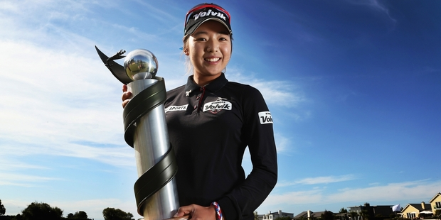 Mi Hyang Lee of Korea with the NZ Women's Open trophy. Photo / Getty Images