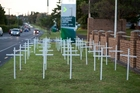 Unitec students installed 50 white crosses  outside  the campus on Friday to protest  over the loss of  teaching staff, but they were promptly removed by grounds staff.