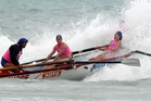 Westshore club sweep Trevor Miles, left, keeps Charlotte Wilson and Brooke Spencer on track despite a crashing wave in the women's long-course  race yesterday at Waimarama Beach. Photo / Paul Taylor