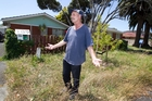 Chris Mills, who lives in a lawn-free Ellerslie property, has had an ongoing dispute with Auckland Transport  over mowing  the council's berm.  Photo / Richard Robinson