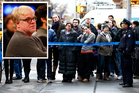 People look toward the home of Philip Seymour Hoffman in New York. Photo / AP , Getty Images