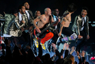 The Red Hot Chili Peppers and Bruno Mars perform during the halftime show of the NFL Super Bowl XLVIII football game between the Seattle Seahawks and the Denver Broncos. Photo/AP