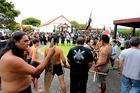 Prime Minister John Key and his party are taken into the whare on Te Tii marae at Waitangi ahead of Waitangi Day. PHOTO/ John Stone