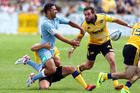Benji Marshall of the Blues hits the defence of Tim Bateman and Andre Taylor of the Hurricanes during the Super Rugby Trial Match between the Blues and the Hurricanes. Photo/Darren Taumata