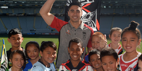 Shaun Johnson pose for a photo with school children to promote a 5 year deal for Auckland to host the NRL Nines Rugby League competition. Photo / Andrew Cornaga