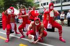 Tongan ninjas collecting for cyclone victims during the rugby sevens parade along Lambton Quay. Photo / Mark Mitchell