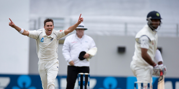 New Zealand Black Cap bowler Trent Boult celebrates hissecond wicket of Indian batsman Cheteshwar Pujara, during the 1st Test Match between New Zealand and India. Photo / Brett Phibbs.