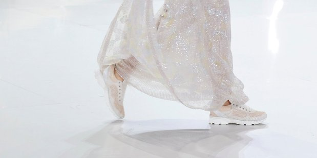 Light-as-air haute couture gowns were paired with down-to-earth sneakers at Chanel. Photo / Supplied