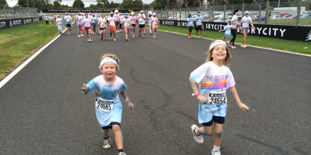 Lachlan Buckley and Maya Keall Flynn at the end of The Color Run.