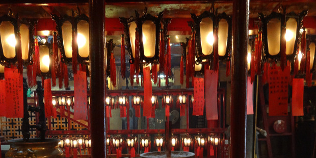 Lanterns hang inside the Man Mo Temple. Photo / Winston Aldworth