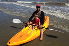 Scotty Stevenson and his son Ethan at Pohara, one of his beaches of choice for summer holidays.