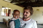 Seth Zwart and one of the children from the orphanage. Photo / Seth Zwart