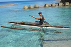Andrew Louis paddles a traditional outrigger canoe in Niue's crystal-clear waters. Photo / Andrew Louis