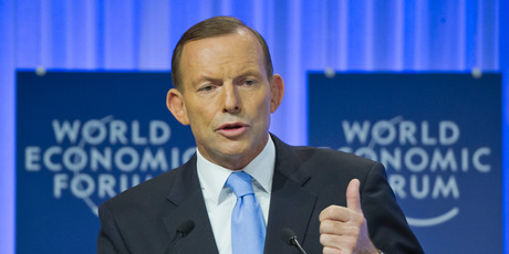 Australian Prime Minister Tony Abbott gestures as he speaks during a session of the World Economic Forum. Photo / AP