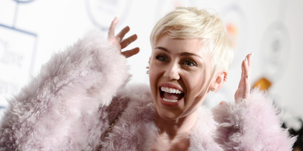 Miley Cyrus strips naked, smokes weed, talks to Ronan Farrow for the cover of 'W'. Photo / AP