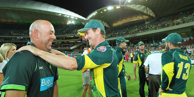 Australian coach Darren Lehmann, left, has a light moment with George Bailey. Photo / AP