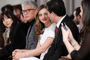 Supermodel Miranda Kerr, center, sits with Korean business executives at New York fashion week. Photo / AP