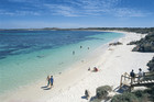 Holidaymakers make the most of Rottnest Island's beautiful white sand beaches and sparkling water.