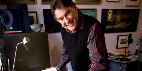 Peter Simpson at home, with one of the books he has handcrafted. Photo / Dean Purcell