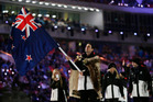 Shane Dobbin of New Zealand carries the national flag as he leads his team into the stadium, during the opening ceremony of the 2014 Winter Olympics in Sochi, Russia. Photo / AP