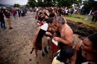 The waka crews take part in celebrations on a wet and cold day in Waitangi. Photo / Dean Purcell