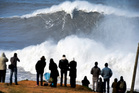 Andrew Cotton rides a giant wave at Praia do Norte, north beach, in Nazare, in Portugal's Atlantic coast. Photo / AP