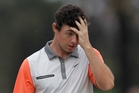 Rory McIlroy rues his chances on the 18th as his challenge fades. Photo / AP