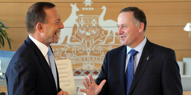 Tony Abbott and John Key seemed to be on the same page at the Commonwealth parliamentary offices in Sydney yesterday. Photo / AP