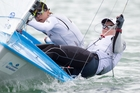 Jo Aleh (left) and Polly Powrie sailed strongly on the final day to cement the title, while Jon-Paul Tobin (right) had a clean sweep of wins in the men's RS:X 9.5 division. Photo / Richard Robinson