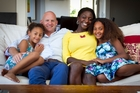 Jamie Whyte with his wife, Zainab Sokona-Whyte, and daughters Khadija, 6, and Rachel, 10. Photo / Natalie Slade