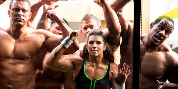 Nascar driver Danica Patrick (centre), wearing a muscle suit, with bodybuilders in the GoDaddy commercial. Photo/ AP