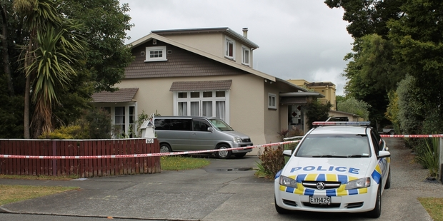 A man was found burned to death and a woman stabbed at a Russell St, Palmerston North, house.