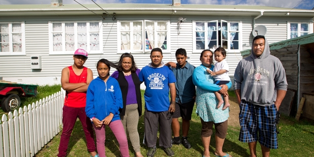 The idea of moving from Thom St in New Lynn doesn't appeal to  (from left) Henry Laveaina, 15,  Melina Laveaina, 13, Hine Laveaina, Mafa Laveaina, Junior  Laveaina, 14, Vai Sefo (with Christian, 18 months) and Fenika Sefo who share a Housing NZ home.  Photo / Richard Robinson