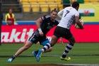 Gillies Kaka tries to stop Fiji's Samisoni Viriviri slip past. PHOTO/DARREN TAUMATA