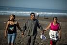 (L-R) The daughter and parents of Salvadorean castaway Jose Salvador Alvarenga, Fatima Mabea Alvarenga, Jose Ricardo Orellana and Maria Julia Alvarenga. Photo / AFP