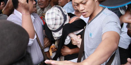 Schapelle Corby covers her face as she walks out of Kerobokan prison, in Bali. Photo / AAP