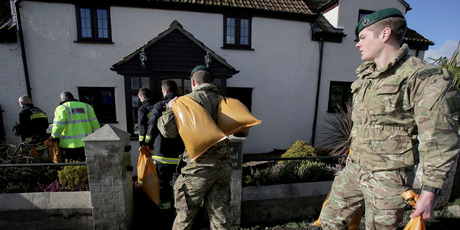 Marines from 40 Commando lay sandbags around a property in Moorland as they help with flood defences on the Somerset Levels near Bridgwater. Photo / Getty Images