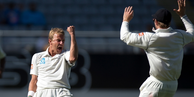 Neil Wagner celebrates the wicket of Zaheer Khan with a fist pump to rival Mick Jagger's. Photo / Brett Phibbs