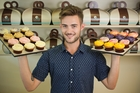 Clinton Richards with Petal Cupcakes - a tasty alternative to flowers. Picture / Greg Bowker