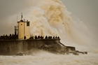 Waves from the Atlantic storm crash on Porthcawl Harbour, South Wales. Photo / AP
